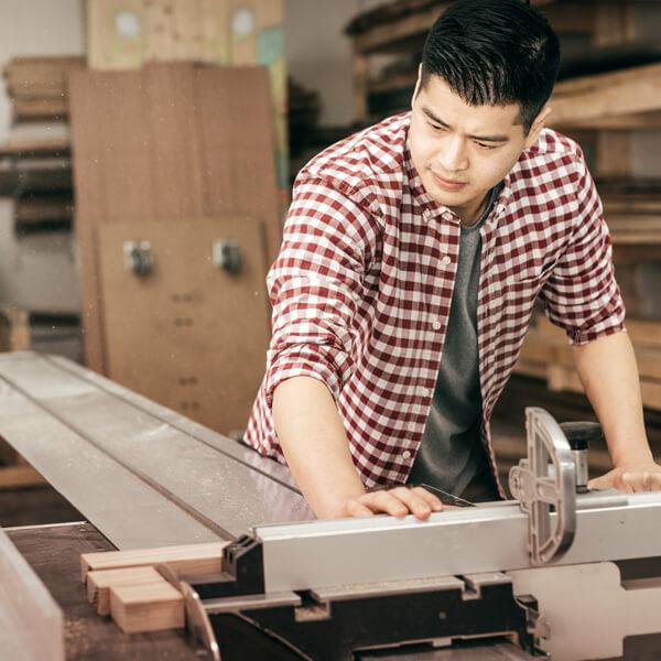 A millennial carpenter working.