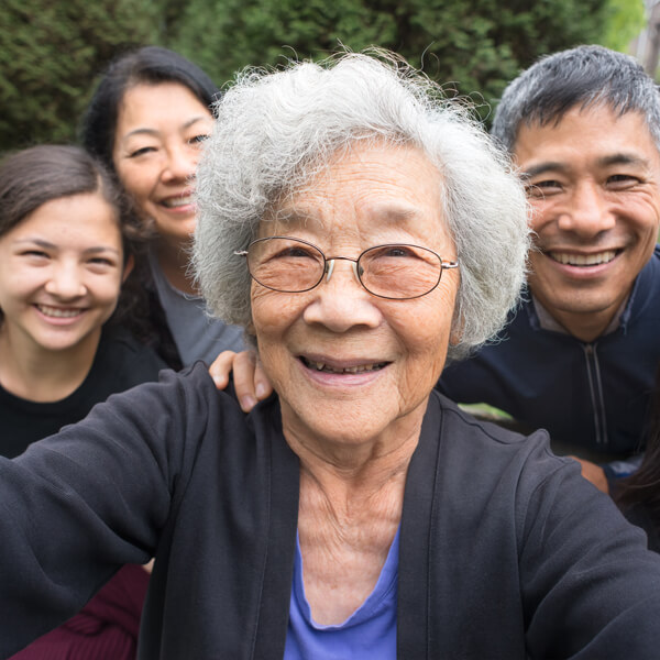 A multi-generational family takes a selfie.