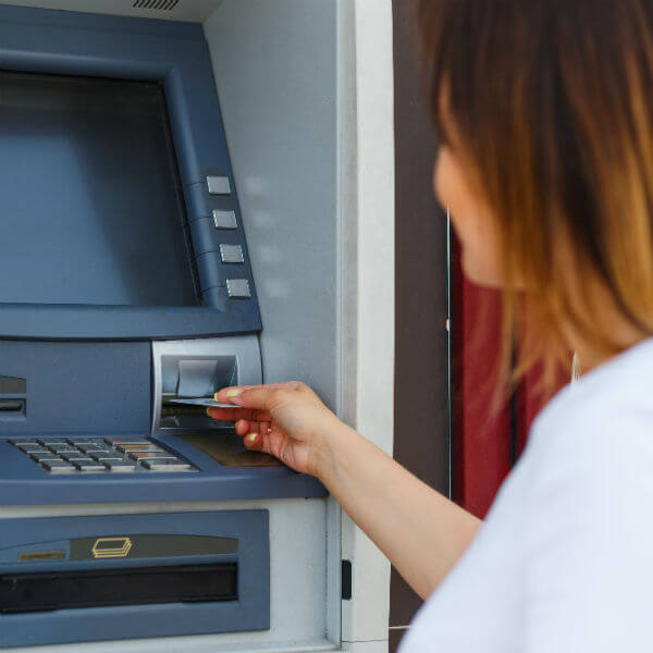 woman using ATM bank machine